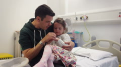 Father Embraces Daughter in Hospital Waiting Room Stock Footage