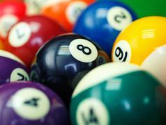 Billiard balls on a green pool table, closeup Stock Photos