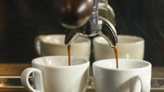 Coffee machine pouring espresso into the cup in slowmotion Stock Footage