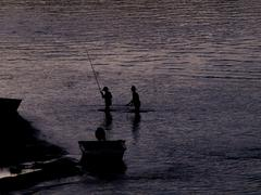 outlines of  fishing boys at river - stock photo