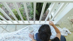 Woman Painting Porch Outdoors Stock Footage