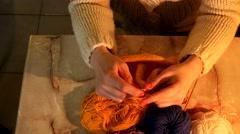 Woman Sitting And Knitting Beautiful Orange scarf, close up Stock Footage