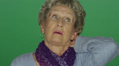 Older woman in disbelief and disappointed, on a green screen background Stock Footage