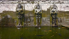 Ancient Fountains fill a Sacred Pool at Tirta Empul Temple Stock Footage