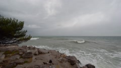 Storm wind and waves on the coast - stock footage