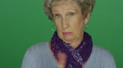 Older woman wagging her finger back and forth Stock Footage