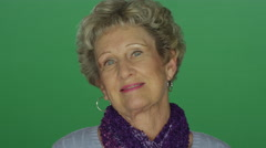 Older woman nodding and smiling, on a green screen background Stock Footage
