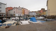 Italy, fish-boats in the harbore in the center of city Muggia Stock Footage