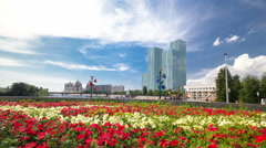 Flowerbed with red and yellow flowers on embankment timelapse hyperlapse on the Stock Footage