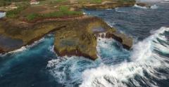 CINEMATIC 4K AERIAL OF MASSIVE WAVES CRASHING AGAINST DEVILS TEAR ROCK CLIFFS - stock footage
