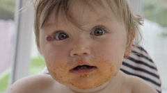 Slow Motion Shot Of Baby Girl Covered In Food Stock Footage