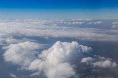 Land view through clouds, aerial photography. - stock photo