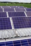 Surface of the a solar panel on field Stock Photos