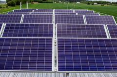 surface of the a solar panel on field - stock photo