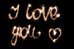 I love you . Inscription sparklers on a dark background. Stock Photos