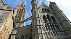 Gothic facade and tall belfry of the Church of Our Lady, Bruges, Belgium - stock footage