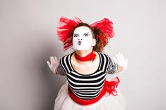 Portrait of the woman as mime sending a kiss. Concept of love and april fools Stock Photos