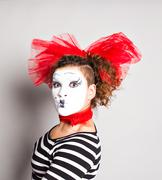 A woman clown mime posing in studio, april fools day concept Stock Photos