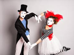 Two mimes  shows the heart. Pantomime heart, love concept, April Fools Day - stock photo