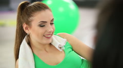 Beautiful sports girl relaxing after workout  in fitness centre Stock Footage