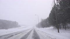 Blurry dangerous car driving conditions on highway at heavy snow fall. 4K Stock Footage