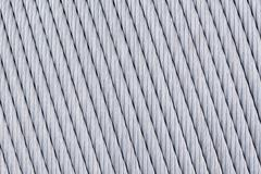 Big thick metal wire is wound on the spool abstract background texture Stock Photos