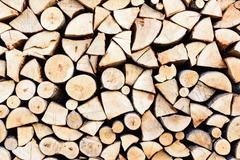 Stock Photo of a pile of chopped wood for the stove to heat the winter in the cold
