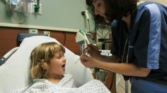 Nurse getting oral temperature of little boy in hospital Stock Footage