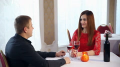 Man and woman romantic evening in restaurant drinking wine love, Valentine's Day Stock Footage