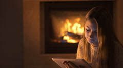 Young girl is resting at home and using tablet . Stock Footage
