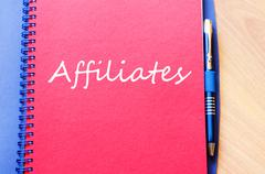 Affiliates write on notebook Stock Photos