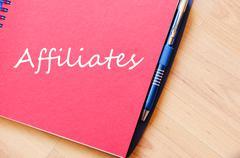 Affiliates write on notebook Stock Photos