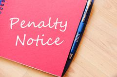 Penalty notice write on notebook Stock Photos