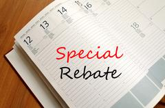 Special rebate write on notebook Stock Photos