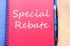 Special rebate write on notebook - stock photo