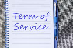 Term of service write on notebook Stock Photos