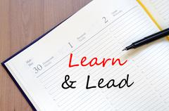 Stock Photo of Learn & Lead write on notebook