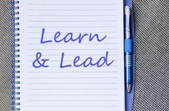 Learn & Lead write on notebook Stock Photos