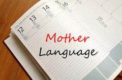Mother language write on notebook Stock Photos