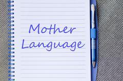Mother language write on notebook - stock photo