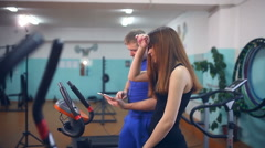 Stock Video Footage of girl athlete drinking water get tired in gym sport trainers