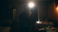 Man and woman kiss silhouette couple light night romance cafe Stock Footage
