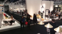 Crowd of people visiting the Stockholm Furniture and light fair exhibition Arkistovideo