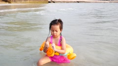 Close up Little Girl in Safety Belt Swimming at Beach Stock Footage