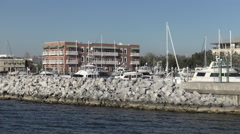 Marina protected with rock barrier Stock Footage