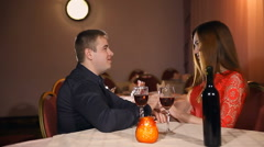 man and woman romantic kiss evening in love candle restaurant Valentine's Day - stock footage