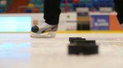 Hockey player training his shot, slowmotion Stock Footage