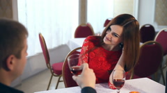 man and woman romantic evening love in restaurant Valentine's Day drinking wine - stock footage