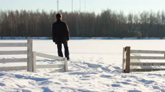 Man alone in the snowy world Stock Footage