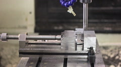 CNC machine milling some steel part - stock footage